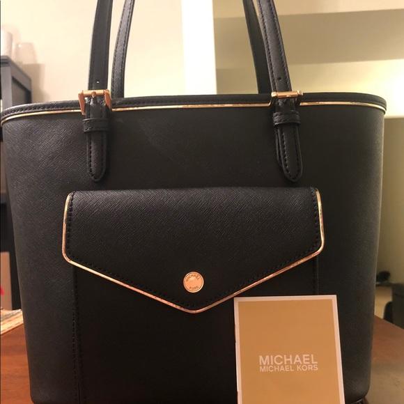 5ac2ce2fcb42 Michael Kors Black bag with Gold Trim. M 5c37eb8ade6f621f6650669f